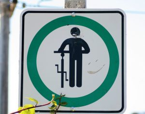 Cyclist dismount sign